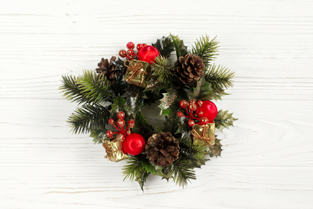 christmas vintage wreath on stylish rustic white wooden background. space for text. holiday greeting card concept. unusual creative top view Stock Photo