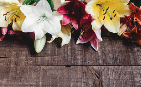 beautiful colorful lily flower on rustic wooden background. gorgeous bloom lilies on rustic wood backdrop. space for text. greeting card. celebration concept. spring background, top view Zdjęcie Seryjne