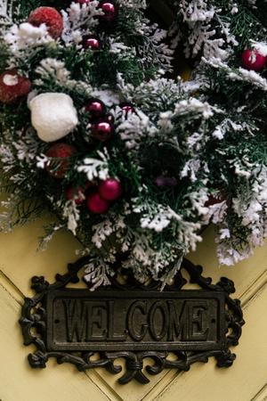 stylish amazing christmas wreath on geometry door, celebration decoration for holidays in the city Stock Photo