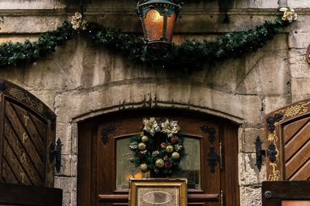 stylish luxury christmas wreath on vintage door, celebration decoration for holidays in the city Stock Photo