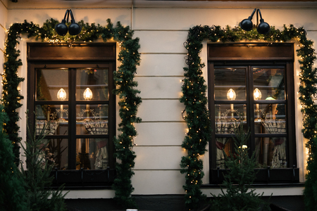 stylish luxury  christmas  vintage garland on window, celebration decoration for holidays in the city Stock Photo