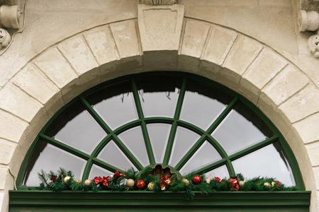 stylish luxury  christmas  vintage garland on window, celebration decoration for holidays in the city Stock Photo