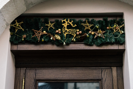 stylish luxury  christmas  vintage garland on old wall, celebration decoration for holidays in the city