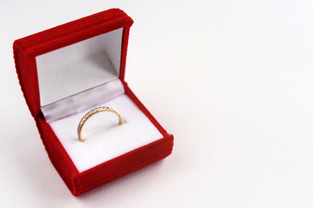 stylish luxury ring with diamond in red box on white background, present and love concept, valentines day