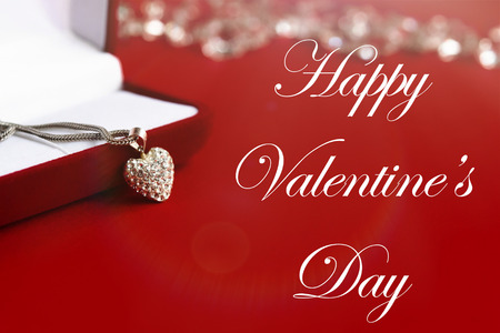expensive: luxury heart necklace, happy valentines day text, greeting card concept Stock Photo