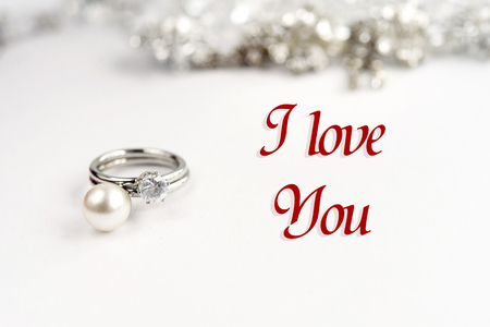 expensive: stylish luxury rings, i love you text, greeting card concept