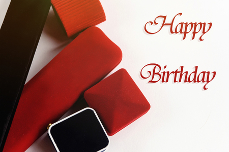 stylish luxury accessories and gift boxes, happy birthday text, greeting card concept Stock Photo