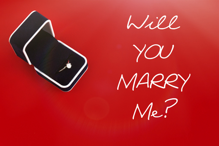stylish luxury ring with diamond, will you marry me text, greeting card concept