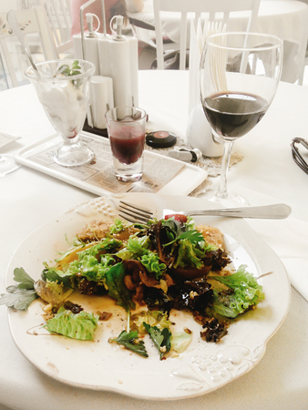 delicious salad caesar on luxury plate and wine, gorgeous catering in restaurant Stock Photo