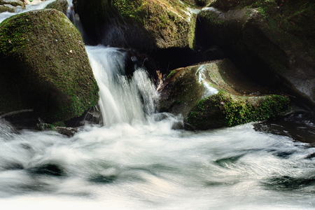 beautiful waterfall and rocks in river in europe mountains, travel explore concept 版權商用圖片