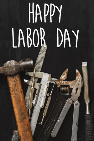 happy labor day text sign. Working tools on black background top view. instruments set for hand work and repairing. Renovation concept flat lay, copy space. Stock Photo - 84490866
