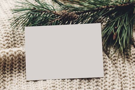 christmas empty card. blank christmas note or wish list on stylish simple knitted sweater with fir for christmas holidays. eco design. xmas  seasonal greetings mock up. letter to santa claus