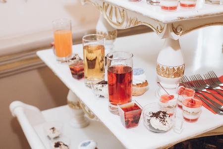 delicious juice and desserts sweet on table at wedding reception in restaurant. luxury catering. christmas feast. wedding candy bar