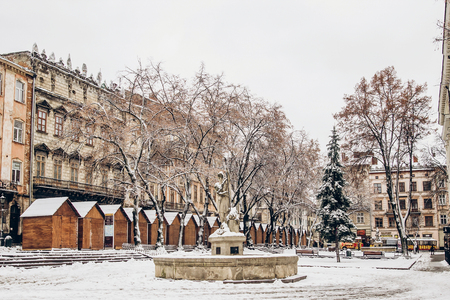 beautiful city center covered in snow. snowy town square in Lviv. european city before christmas holidays Archivio Fotografico