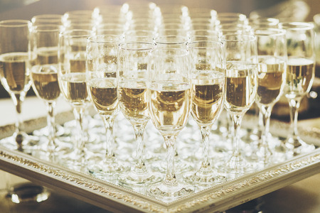 stylish glasses of champagne at luxury wedding reception. rich celebration. expensive catering at feast. new year and christmas celebrations and drinks