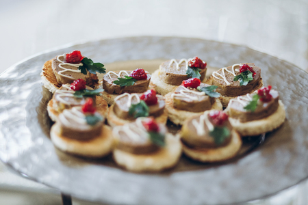 delicious canape with paste on plate on table at wedding reception. luxury catering at celebrations