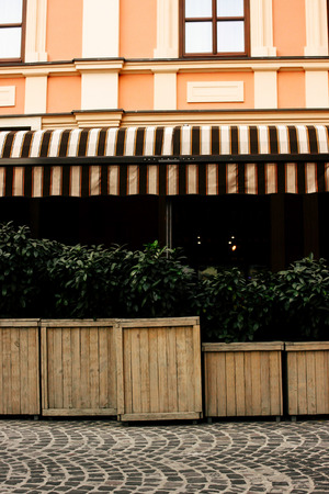 beautiful exterior of restaurant terrace in sunny street in european city Stock Photo - 99344780