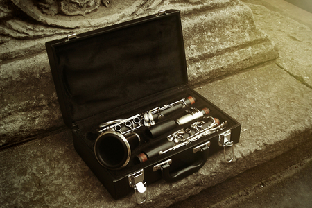 beautiful black and silver clarinet in classic case on background of old city, space for text Stock Photo