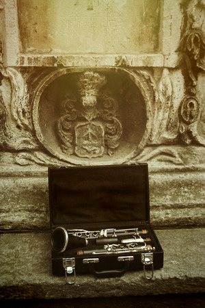 beautiful black and silver clarinet in classic case on background of old city, space for text Stockfoto