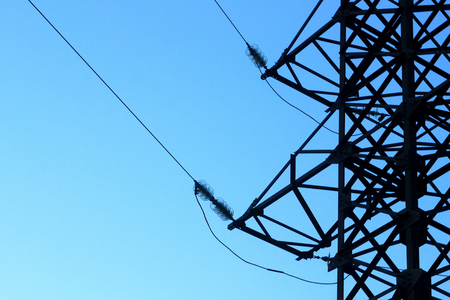 power line tower on the background of blue sky, electricity energy concept