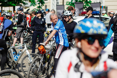 Lviv, Ukraine - May 6, 2017: cycling marathon VIII Lviv 100km ride, 425 bicycles, in the streets of the city. participants and athletes riding bikes. old man waiting for start Editorial