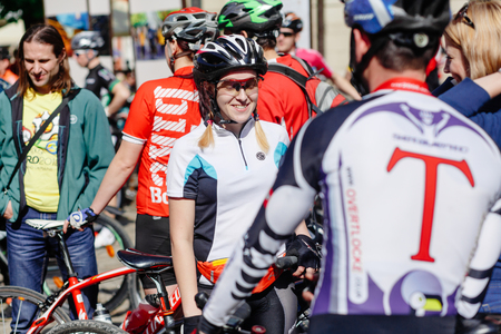 Lviv, Ukraine - May 6, 2017: cycling marathon VIII Lviv 100km ride, 425 bicycles, in the streets of the city. participants and athletes riding bikes. people in form and helmet talking