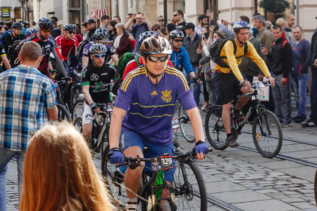 Lviv, Ukraine - May 6, 2017: cycling marathon VIII Lviv 100km ride, 425 bicycles, in the streets of the city. participants and athletes riding bikes. man in helmet and form racing on bike Editorial