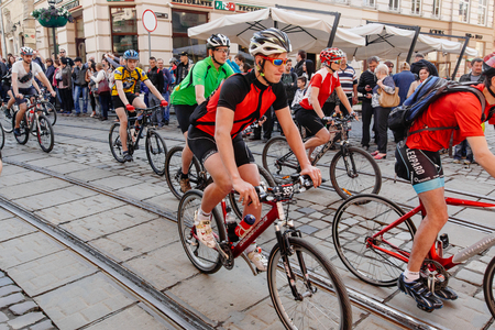 Lviv, Ukraine - May 6, 2017: cycling marathon VIII Lviv 100km ride, 425 bicycles, in the streets of the city. participants and athletes riding bikes. man in colorful uniforms racing