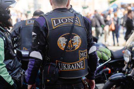 Lviv, Ukraine - May 6, 2017: cycling marathon VIII Lviv 100km ride, in the streets of the city. brutal man on stylish steel vintage motor bike, participants riding bikes, ukraine lions Editorial