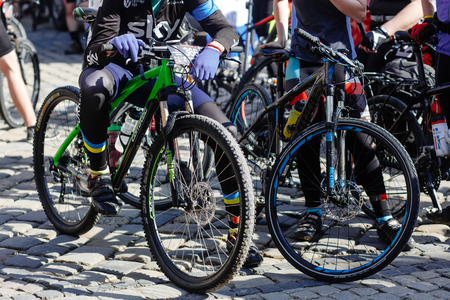 Lviv, Ukraine - May 6, 2017: cycling marathon VIII Lviv 100km ride, 425 bicycles, in the streets of the city. participants and athletes riding bikes. bike wheel close up