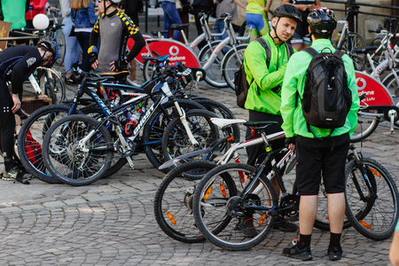 Lviv, Ukraine - May 6, 2017: cycling marathon VIII Lviv 100km ride, 425 bicycles, in the streets of the city. participants and athletes riding bikes. man in green form talking Editorial