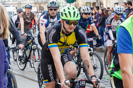 Lviv, Ukraine - May 6, 2017: cycling marathon VIII Lviv 100km ride, 425 bicycles, in the streets of the city. participants and athletes riding bikes. mass start, people in uniform