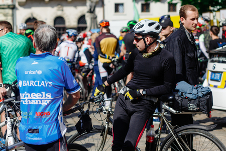 Lviv, Ukraine - May 6, 2017: cycling marathon VIII Lviv 100km ride, 425 bicycles, in the streets of the city. participants and athletes riding bikes. poeple waiting for start