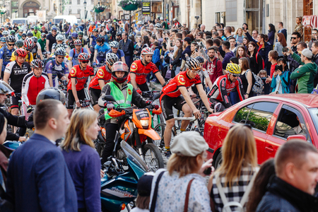 Lviv, Ukraine - May 6, 2017: cycling marathon VIII Lviv 100km ride, 425 bicycles, in the streets of the city. participants and athletes riding bikes. man in red form bicycling Editorial