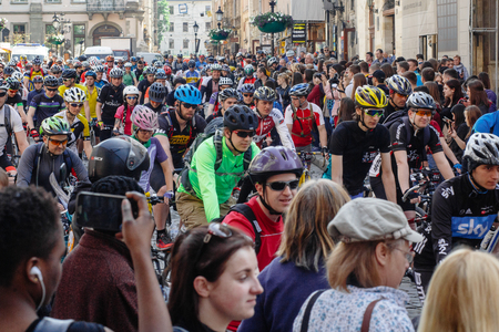 Lviv, Ukraine - May 6, 2017: cycling marathon VIII Lviv 100km ride, 425 bicycles, in the streets of the city. participants and athletes riding bikes. man in helmet and form racing on bike, mass start