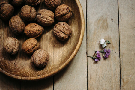 natural  nuts and  in a stylish unique rustic bowl on a wooden background Stok Fotoğraf