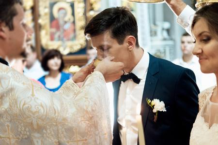 wedding ceremony of stylish elegant  bride and groom in the  church, Communion