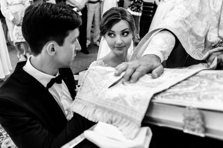 stylish luxury bride and elegant groom, making oaths, emotional wedding ceremony Stock Photo