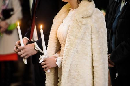 stylish luxury bride and elegant groom, making oaths, emotional traditional  wedding ceremony Stock Photo