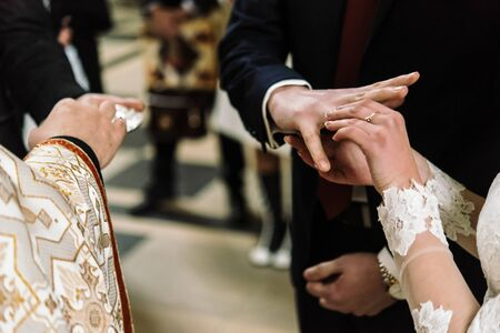 stylish luxury bride and elegant groom, making oaths, emotional traditional  wedding ceremony 版權商用圖片
