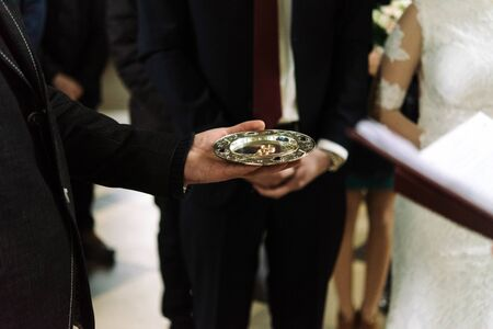 priest blessing luxury wedding rings in the old church Stock Photo