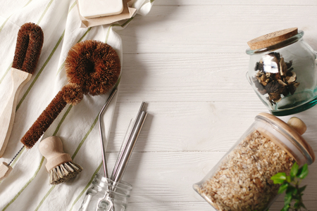 sustainable lifestyle concept. zero waste. eco natural coconut soap and brushes for washing dishes, metal straws, granola in glass, eco friendly flat lay. plastic free items.  reuse, reduce