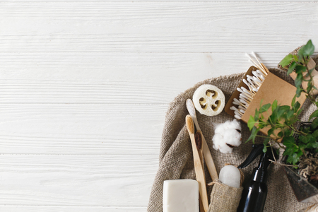 plastic free items. eco natural bamboo toothbrush, crystal deodorant,luffa, coconut soap,brushes,ear sticks, cotton. sustainable lifestyle concept. zero waste home, lat lay Banco de Imagens