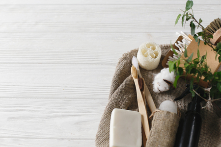 plastic free items. eco natural bamboo toothbrush, crystal deodorant,luffa, coconut soap,brushes,ear sticks, cotton. sustainable lifestyle concept. zero waste home, green Stock Photo