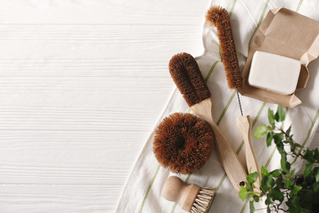eco natural coconut soap and brushes for washing dishes, eco friendly flat lay. sustainable lifestyle concept. zero waste food cleaning. plastic free items. reuse, reduce, recycle