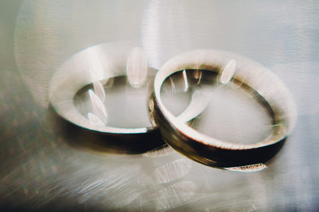 Luxury modern wedding  golden rings, macro view. Marriage and holy matrimony concept