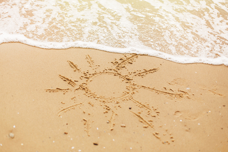 Hello summer vacation concept. Sun written on sandy beach and sea waves. Relaxing on tropical island. Lets go travel