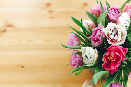 Beautiful double peony tulips in vase, top view with copy space. Colorful pink and purple tulips bouquet in vase. Happy mothers day. International women's day. Hello Spring. Greeting card