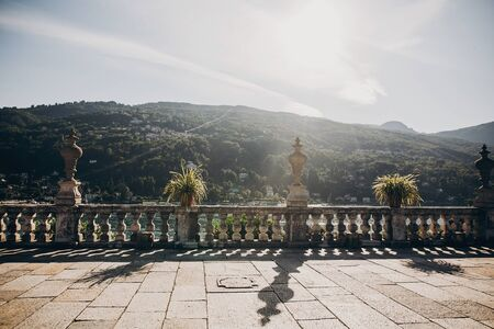 Beautiful view of stone landmarks and terrace on mountain at Lago Maggiore in sunny light, exploring Borromean Islands, Italy. Old architecture monuments in Stresa 写真素材