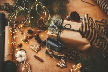 Stylish rustic christmas gifts with cedar branches and cinnamon decoration Stok Fotoğraf